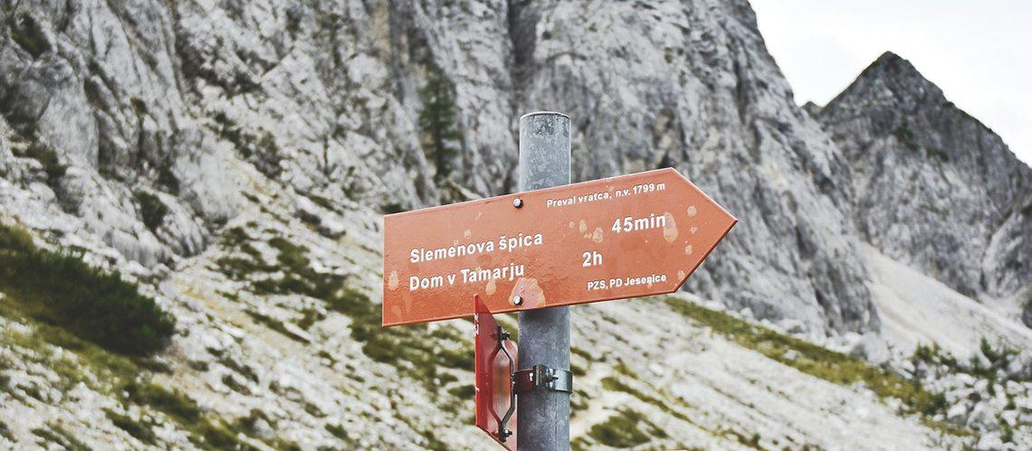Red hiking waysign in Triglav National Park