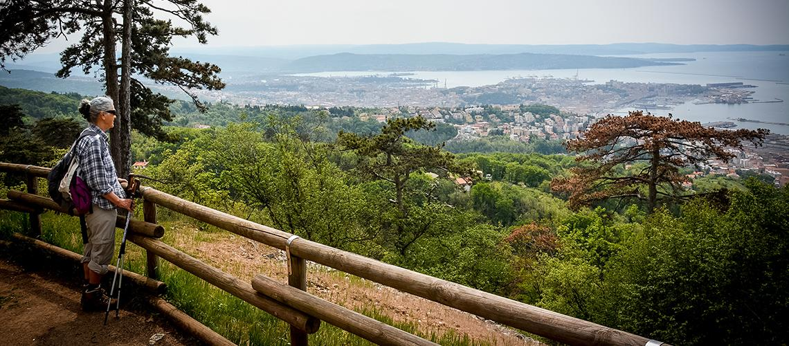 Lady hiker at viewpoint of Italian City Trieste